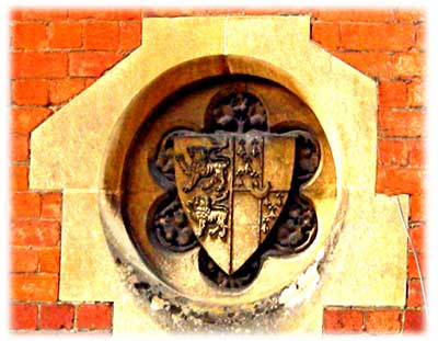 Crest on Madresfield school building