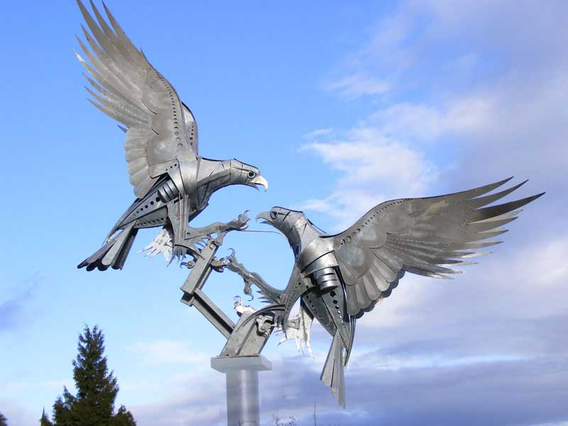 Sculpture of two buzzards in flight